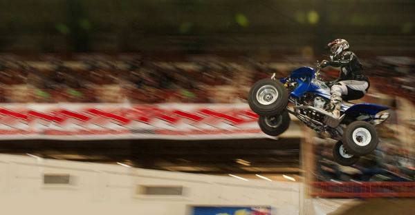 Quad racer soaring through the air at Motorama 2012, Pennsylvania Farm Show Complex, Harrisburg, PA
