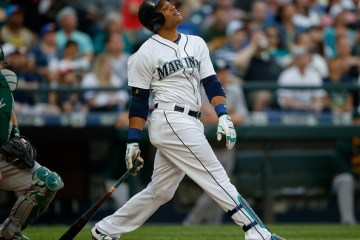 SEATTLE, WA - MAY 09: Robinson Cano #22 of the Seattle Mariners flies out against the Oakland Athletics at Safeco Field on May 9, 2015 in Seattle, Washington. (Photo by Otto Greule Jr/Getty Images)