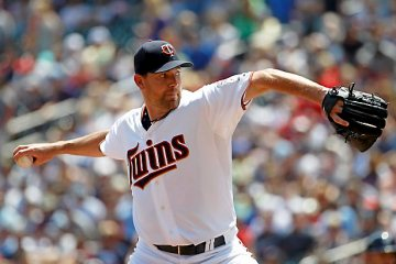 Minnesota Twins starting pitcher Mike Pelfrey delivers to the Milwaukee Brewers during the first inning of a baseball game in Minneapolis, Sunday, June 7, 2015. (AP Photo/Ann Heisenfelt)