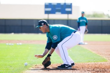 Dae-Ho Lee does drills at first base as the full squad reports for the first time this year for Seattle Mariners spring training in Peoria, Arizona, Thursday February 25, 2016.