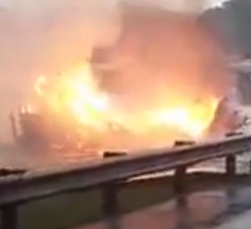 Burning home swept down river in West Virginia flood