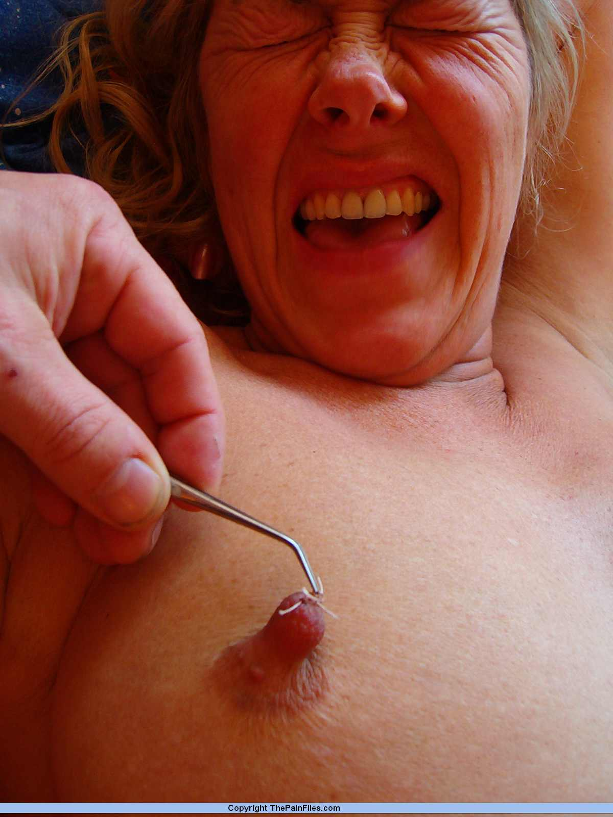 breast torture of women