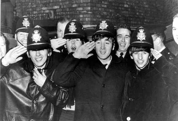 Beatles with West Midlands Police officers.  The Beatles and West Midlands policemen outside Birmingham Hippodrome, 10 November 1963.