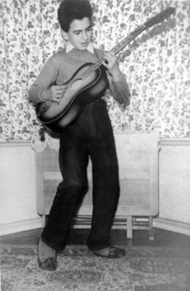George Harrison playing the guitar, circa 1950
