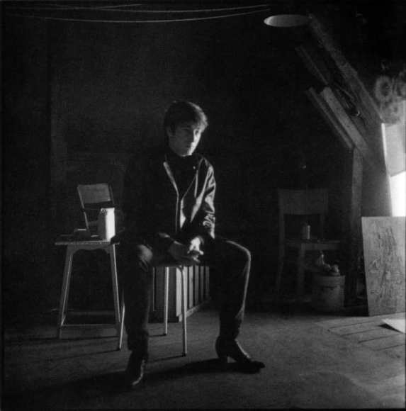 John Lennon in Stuart Sutcliffe's art studio at Astrid Kirchherr's house, 1962