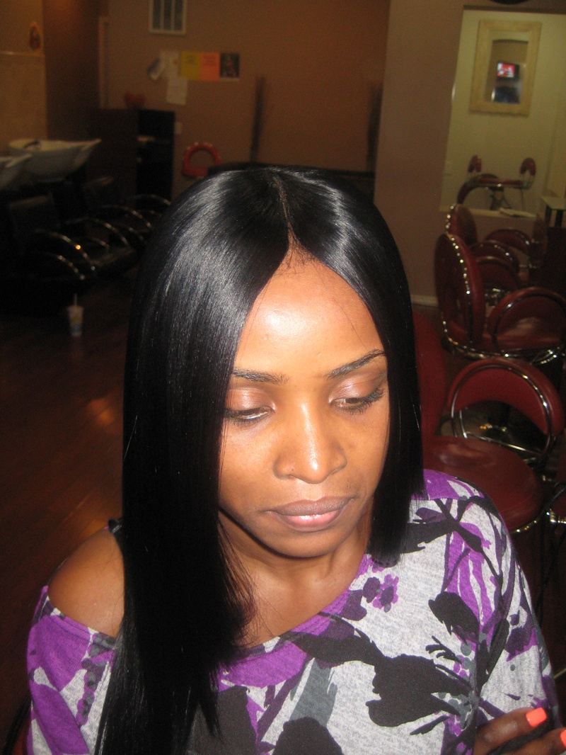 Invisible-Part-Sew-In-Weave-Hairstyles-For-Black-Women.jpg