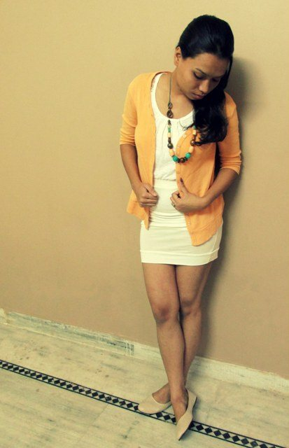 White Mini Skirt with Pastel Orange Shrug Outfit look 3