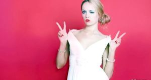 Cool woman wearing white dress on red background
