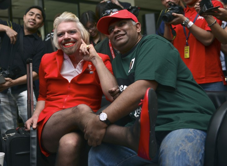 Richard Branson serves as flight-attendant-in-drag for AirAsia passengers