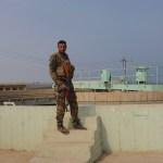 A militia fighter guards a water plant in Haj Ali, Iraq. Red here https://warisboring.com/villagers-return-to-a-town-freed-from-islamic-state-and-arm-themselves-7349d7d0e7e0#.yivmcns18