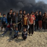 Kids in Qayyara, Iraq, October 2016 Read about the oil wells here http://www.thetimes.co.uk/article/the-day-the-sun-never-rose-bdfgpd93t