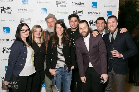 JUNO Award winners Fred Penner and Max Kerman (The Arkells) taking a group photo with guests at the Gibson Guitar party