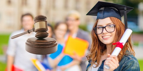 education, campus and teenage concept - smiling teenage girl in corner-cap and eyeglasses with diploma and classmates on the back