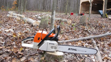 Stihl 034AV in front of some of the trees we cut down today