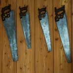 Vintage hand saws on the cabin wall