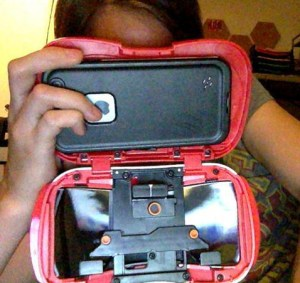 I keep the back open while I watch the side by side videos so I do not have to remove my cellphone's protective case.