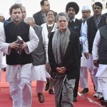 New Delhi: Congress President Sonia Gandhi with his son and party Vice President Rahul Gandhi  leaving after hoisting the party flag  during the 131st foundation day of Congress party function at AICC headquarters in New Delhi on Monday. PTI Photo by Shahbaz Khan(PTI12_28_2015_000017a)