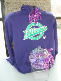 Glass pumpkin filled with candy and purple BHC East Campus sweatshirt
