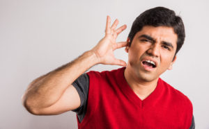 indian male touching is paining ear, indian man stressed with paining ear