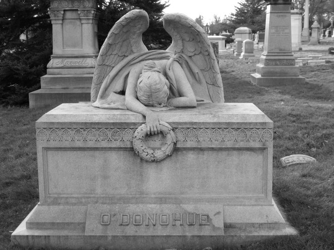 Angel on top of gravestone in the Greenwood Cemetery in Brooklyn - Black & White