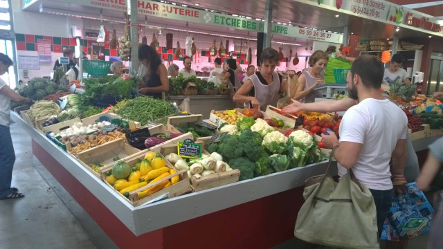 Photograph of vegetables on market stall in Biarritz Market, France.