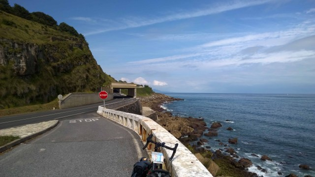 Photograph of Basque Country coast road with road right next to the sea.