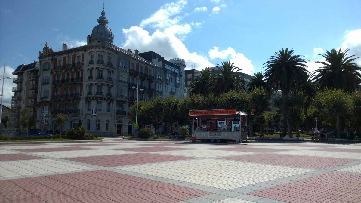 Photograph of empty promenade at Castro Urdiales, except for a chocolate and churros van.