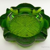 Big, deep retro glass ashtray in thick green glass with embossed foliage decor on the seat. Original Blenko part number 701; it was the first design cataloged in 1970.  In like-new condition.