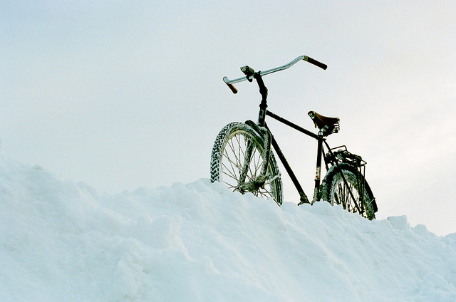my bike on the snow by adamscarroll via Flickr