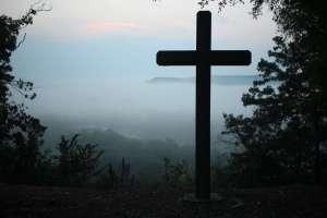 cross and fog mountain