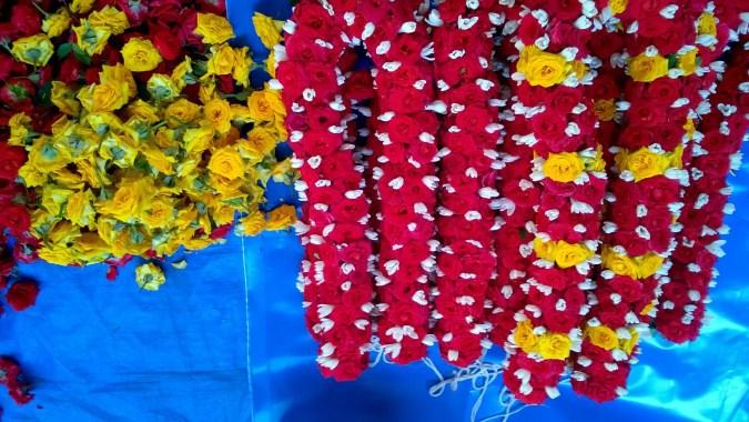 Flower garlands being readied at a local market in Gandhi Bazaar in Bangalore