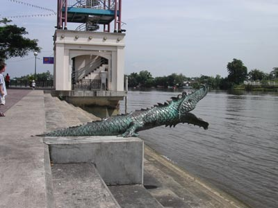 Crocodile statuary at the water's edge