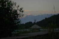 First rays of the morning sun hitting the Trishul peak