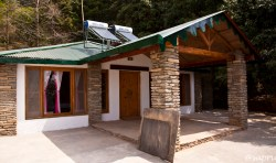 Rhododendron Cottage. Kumaoni cottage - stone, mud walls, bamboo mat ceiling. With a huge private veranda that has magnificent views of the sunset and the rolling hills to the south.