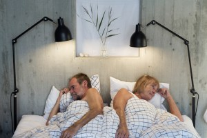 older couple in bed angry