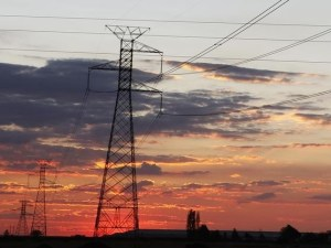 Electricity pylons are seen as the sun sets in Soweto outside Johannesburg. REUTERS/Siphiwe Sibeko