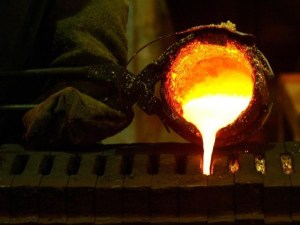 Refined gold is poured into moulds to be made into gold bars at South Africa's Rand Refinery