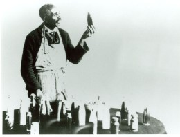 Carver with some of the products that he developed from peanuts, circa 1920