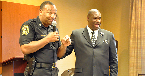 Orrin Hudson with local police officer