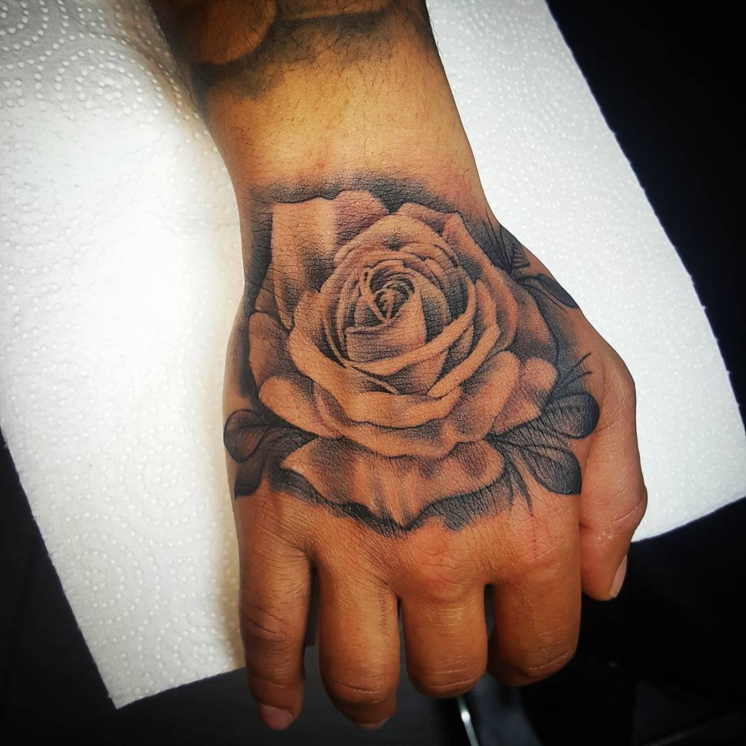 Rose Hand Tattoo , Bladez Barbers and Grooming Room