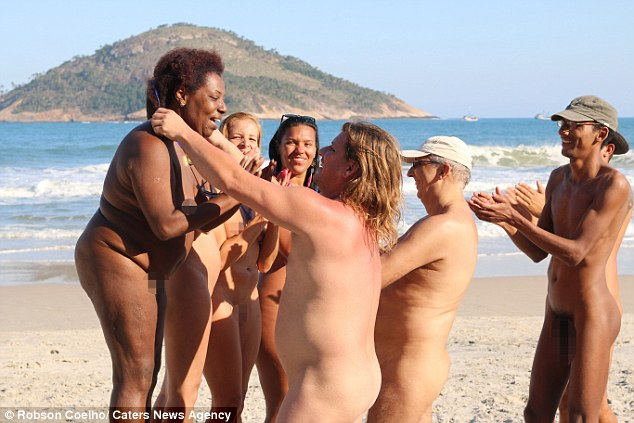 M - Brazil: Topless models protest beach breast