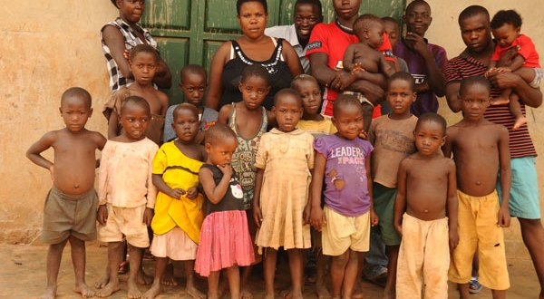Nabatanzi (middle) with her children. Photo by Colleb Mugume