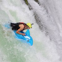 Riding an inflatable pool toy over a waterfall