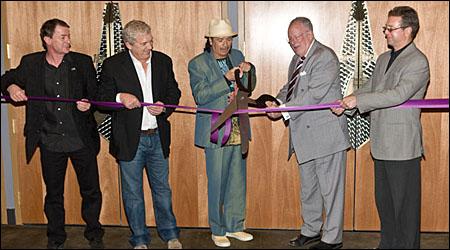 Patrick Berge, John Meglen, Carlos Santana, Mayor Oscar Goodman and Randy Kwasniewski cut the cord on the New Joint. (Photo by Erik Kabik / Retna)