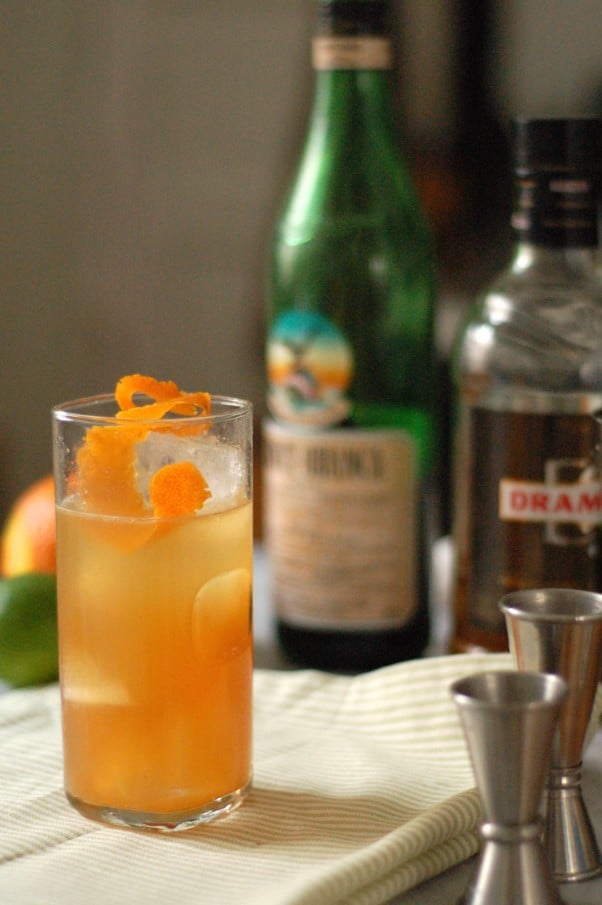 The Kingston Club. A fruity but restrained tiki drink with Drambuie, Fernet Branca, pineapple, and lime topped with fizzy water and an orange twist. From Blossom to Stem | Because Delicious www.blossomtostem.net