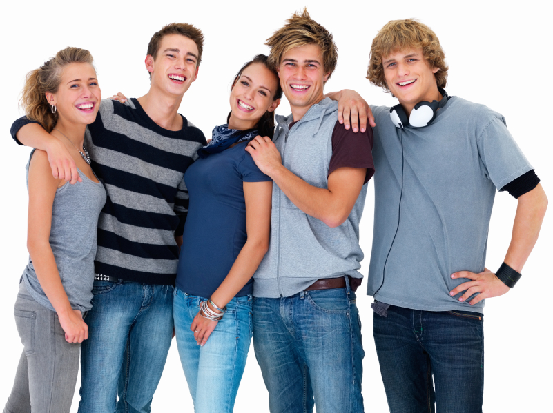 Young friends standing together against white background