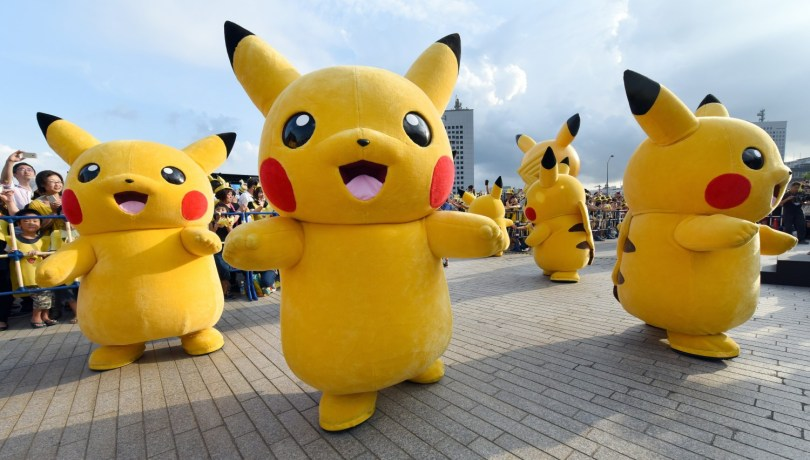 "Dozens of people dressed up as Pikachu, the famous character of Nintendo's videogame software Pokemon, dance with fans as the final of a nine-day ""Pikachu Outbreak"" event takes place to attract summer vacationers in Yokohama, in suburban Tokyo, on August 16, 2015.       AFP PHOTO / Toru YAMANAKA        (Photo credit should read TORU YAMANAKA/AFP/Getty Images)"
