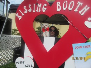 A dog selling kisses for $1.00