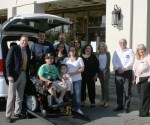 Ken Lebersfeld, CEO Capitol Lighting with Damarius Roman, Parents Mike and Marilyn with Dad's Capitol Lighting coworkers who helped raise funds for the Roman Family's new wheelchair-accessible van.