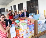 Members of the Junior League of Boca Raton donated nearly 6,000 diapers and pullups, and a pallet of baby and toddler-sized clothes and shoes, blankets, bedding, and a baby crib to Food For The Poor for orphanages in Haiti. Pictured (l to r) Jennifer Brackett, Community Issues Manager for the JLBR, and her daughter Coral; Kirsten Stanley, JLBR President; Jamie Sauer, JLBR Secretary; Tracy Wilson, JLBR Diaper Bank Chair; Angel Aloma, Executive Director of Food For The Poor.